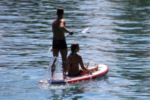 2 people on a paddleboard on the lake